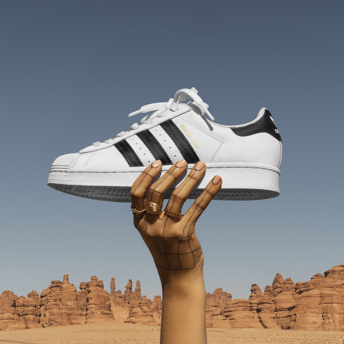 adidas nearly doubles e-commerce sales